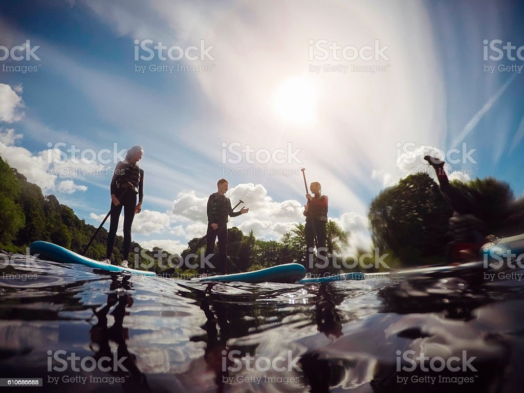 Friends Paddleboarding stock photo