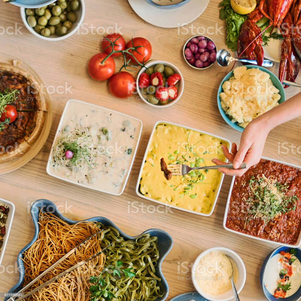 Friends Party Buffet Enjoying Food Concept stock photo