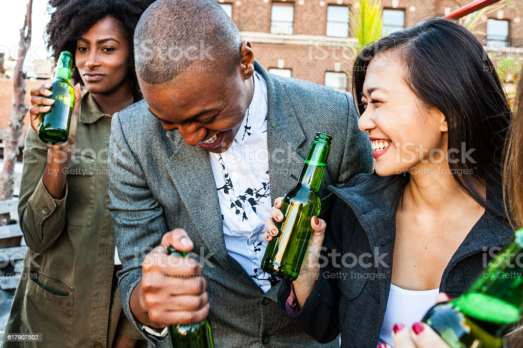 Friends party on a rooftop in New York Manhattan stock photo