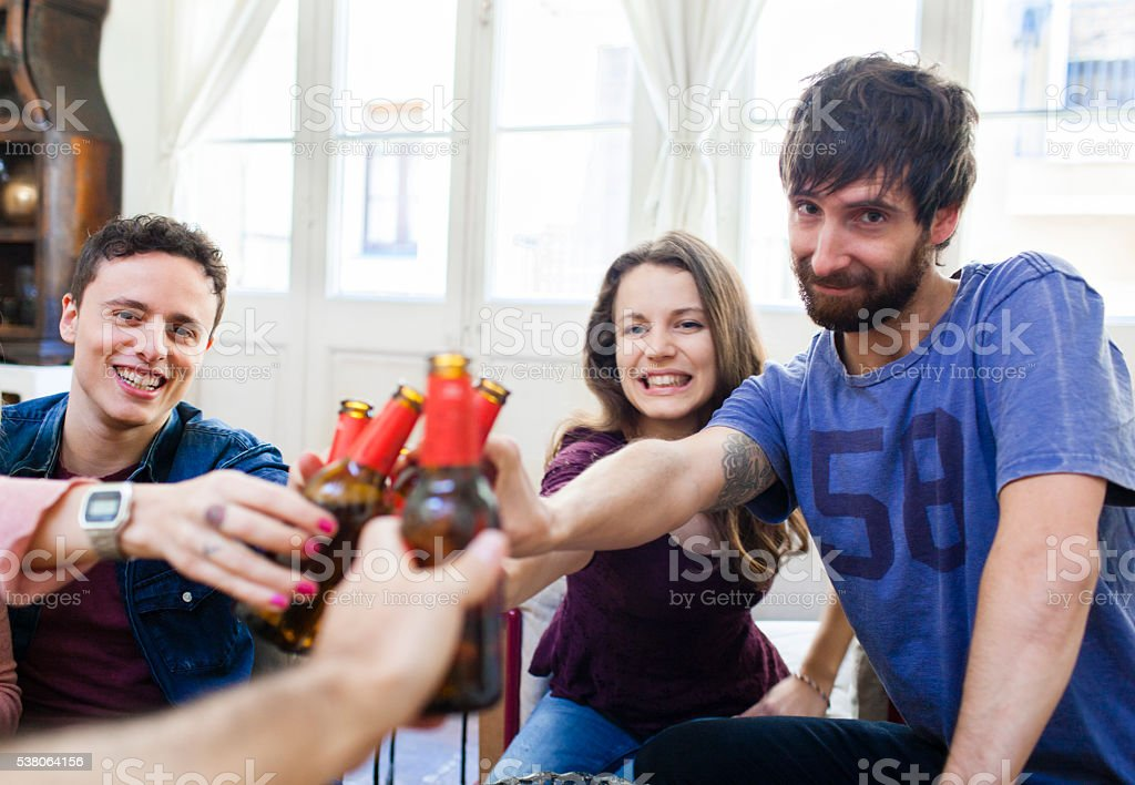 Friends partying and having fun in a loft. stock photo