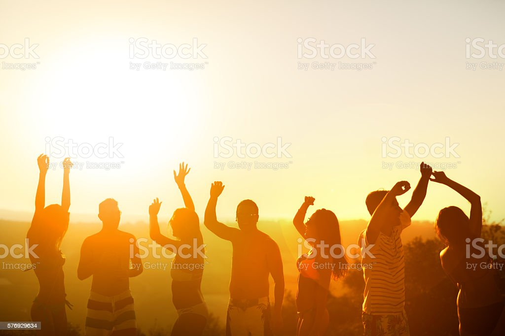 Friends partying during summer vacation stock photo