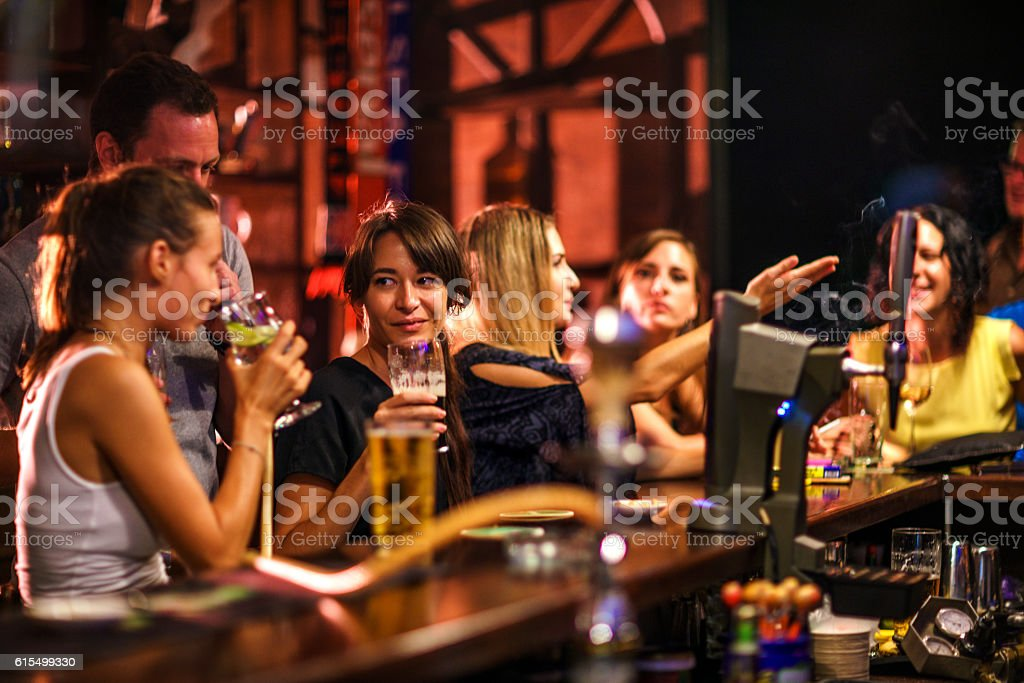 Friends partying in the bar stock photo