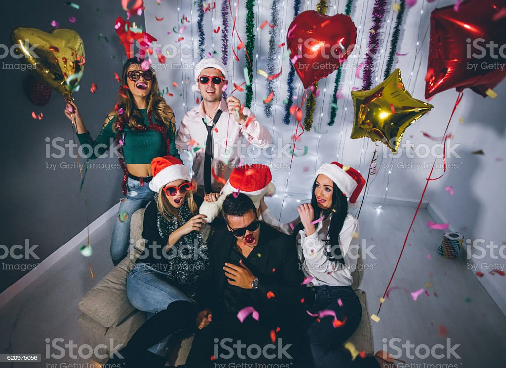 Friends partying on NYE stock photo