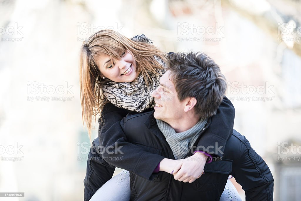 Friends piggyback outdoors royalty-free stock photo