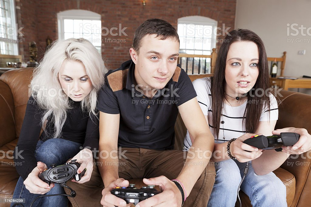 friends play video game royalty-free stock photo