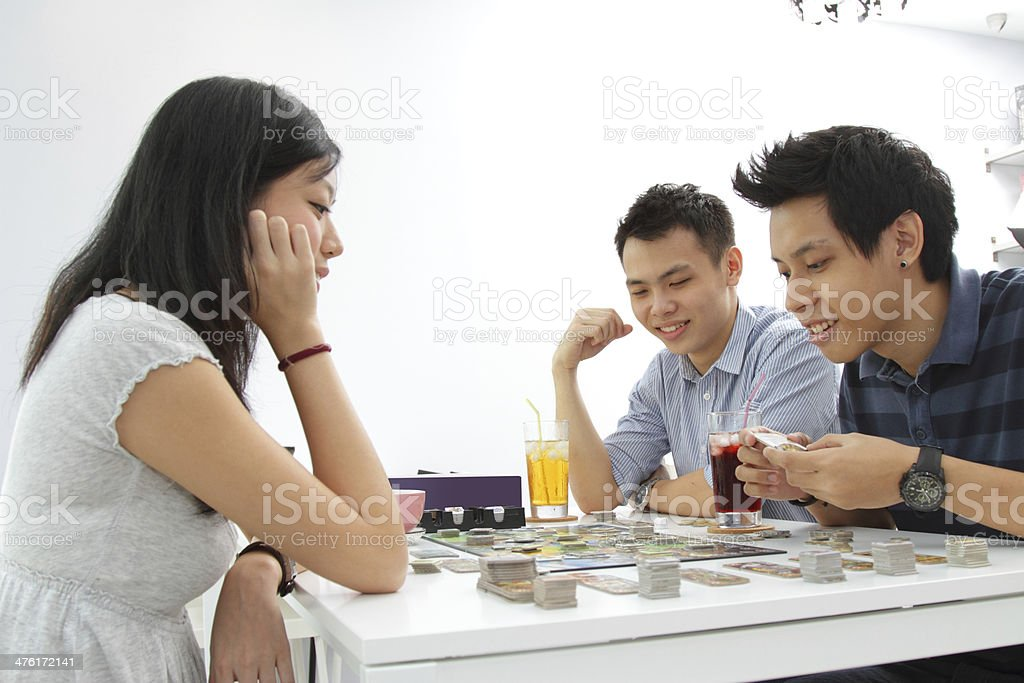 Friends playing a board game stock photo