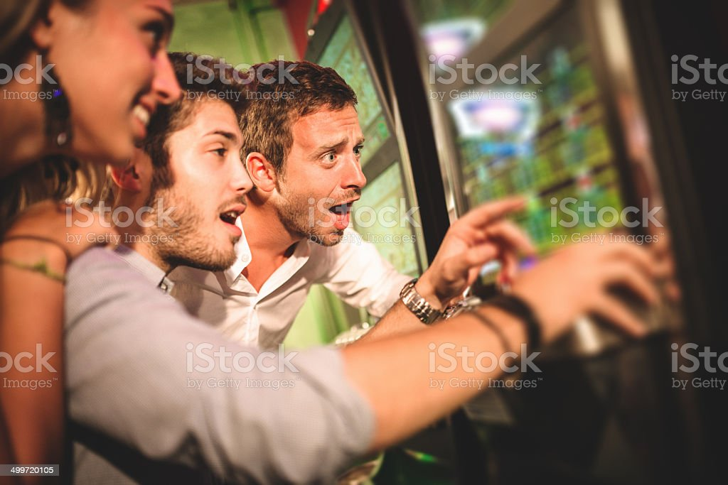 friends playing at casino royalty-free stock photo