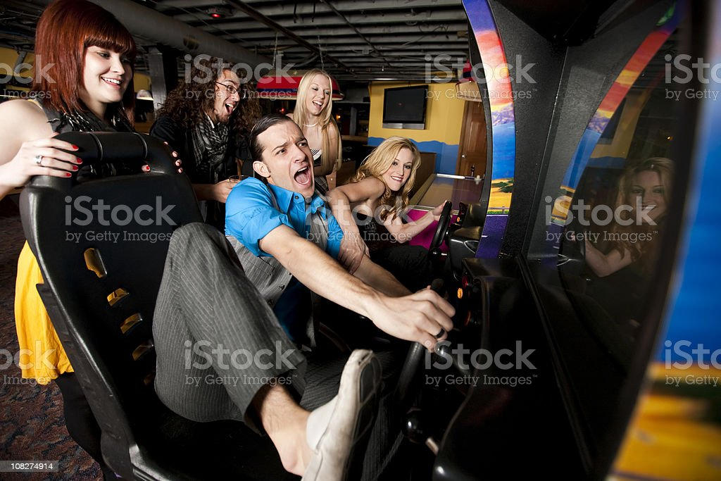 Friends Playing at Video Arcade stock photo