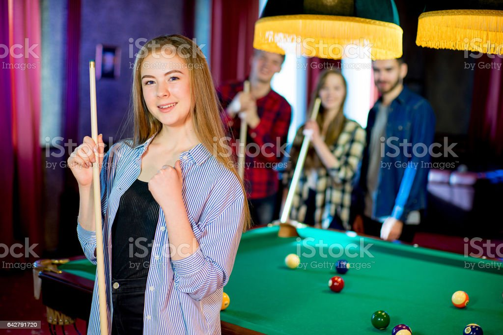 friends playing billiard stock photo