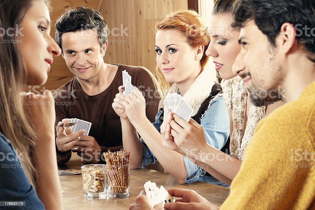 Friends playing card game royalty-free stock photo