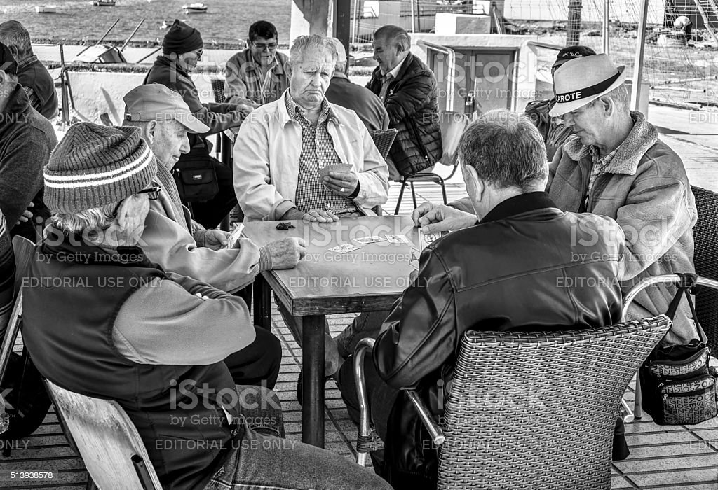 Friends Playing Cards stock photo