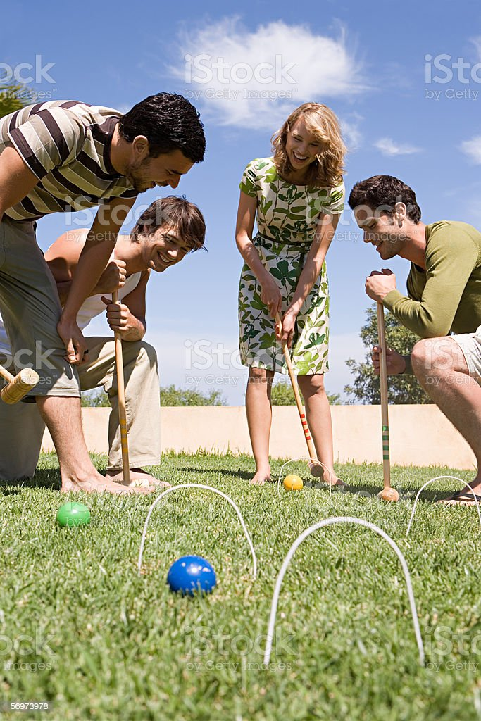 Friends playing croquet stock photo