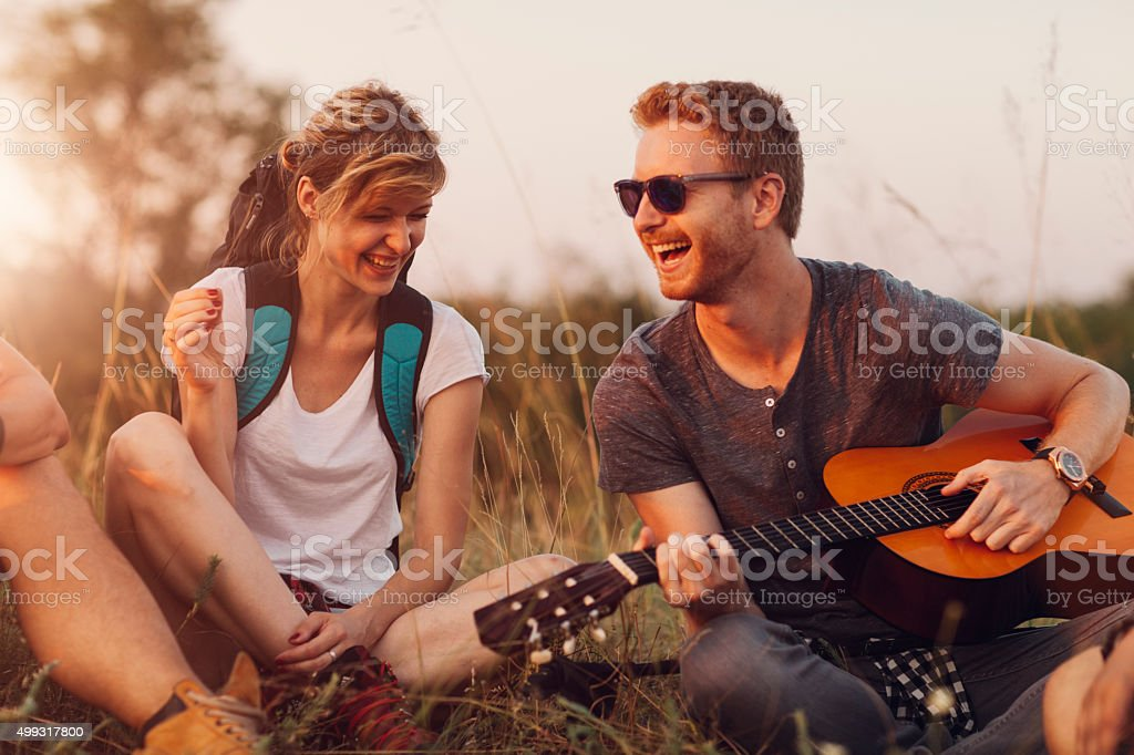 Friends Playing Guitar At Hiking. stock photo