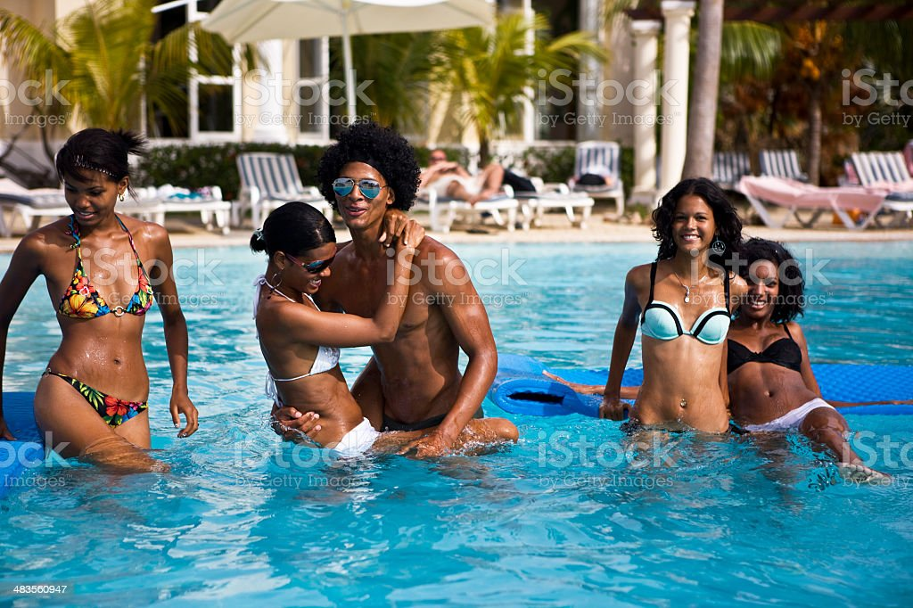 Friends playing in pool royalty-free stock photo