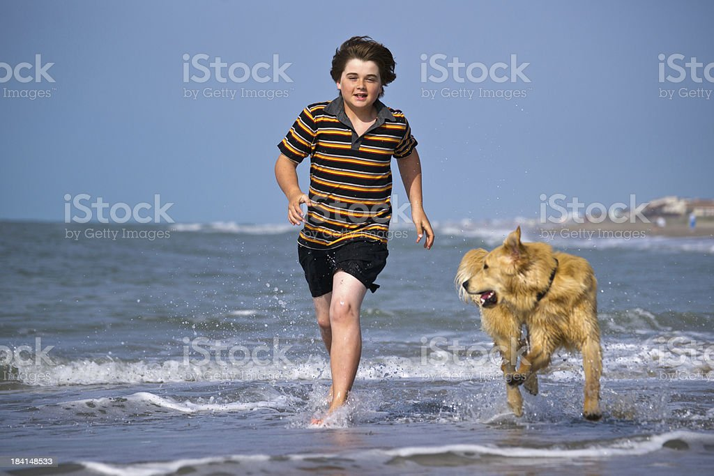 Friends playing in the surf royalty-free stock photo