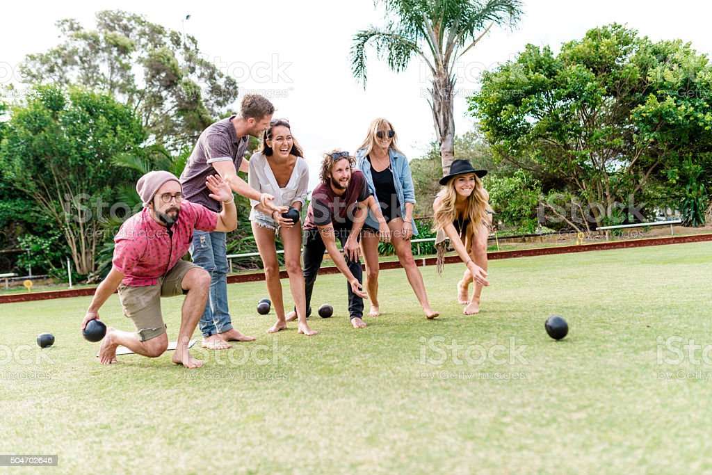 Friends playing lawn bowling stock photo