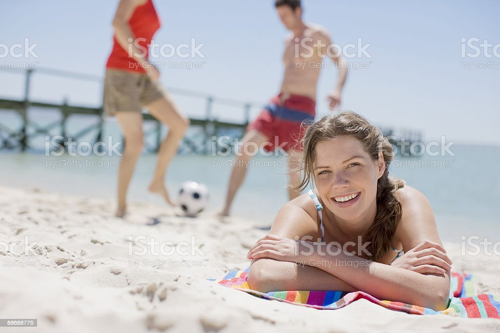 Friends playing on beach stock photo