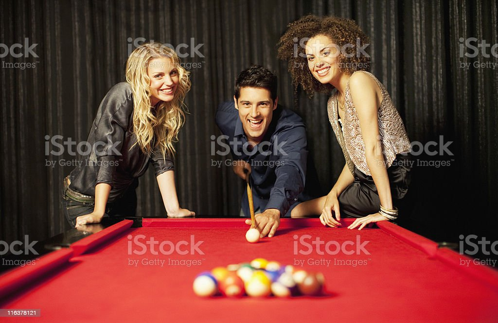Friends playing pool royalty-free stock photo