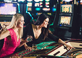 Friends playing roulette at the casino