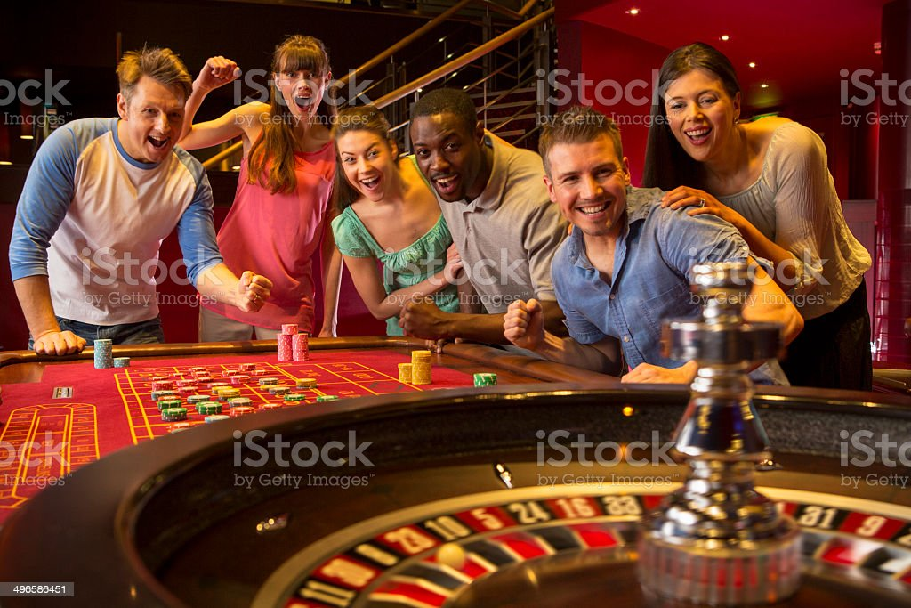 Friends Playing Roulette stock photo