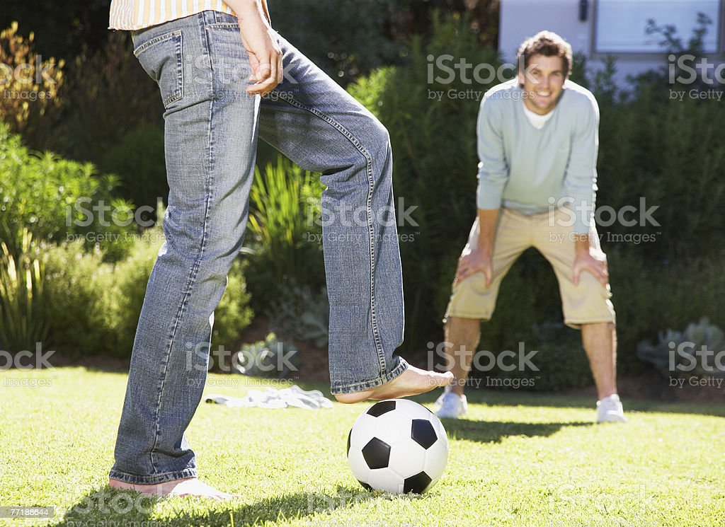 Friends playing soccer royalty-free stock photo
