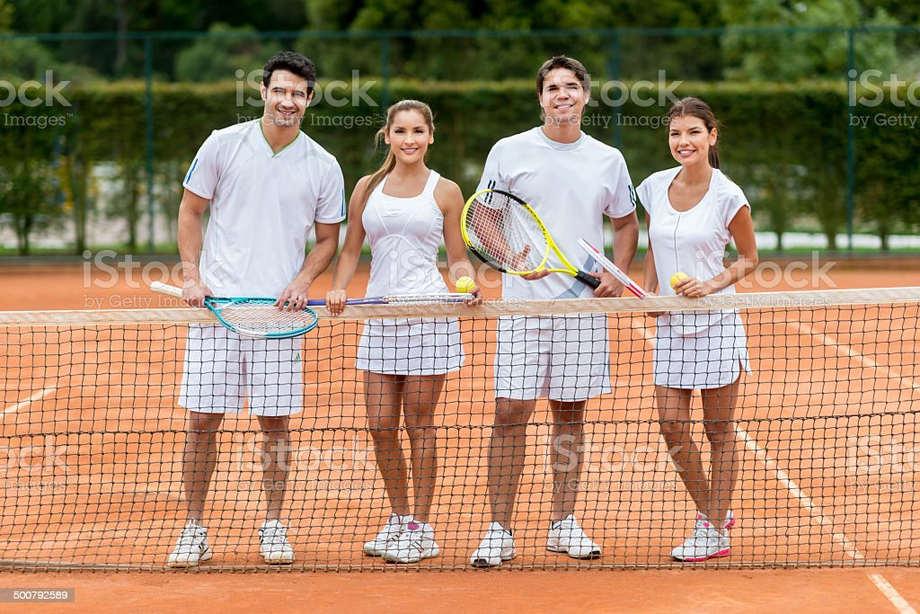 Friends playing tennis stock photo