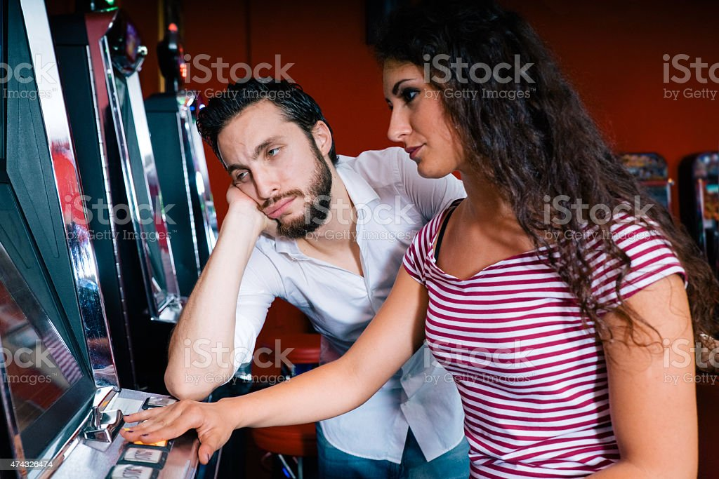 Friends Playing The Slots, Desperate Faces stock photo