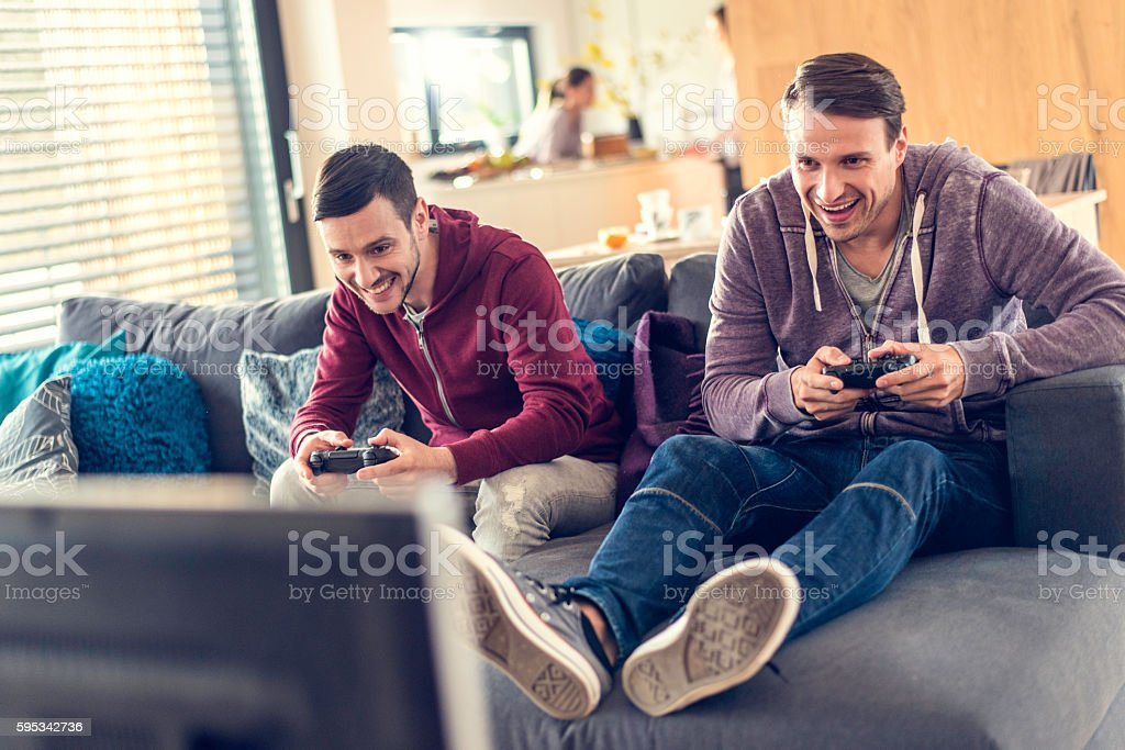 Friends playing video game stock photo