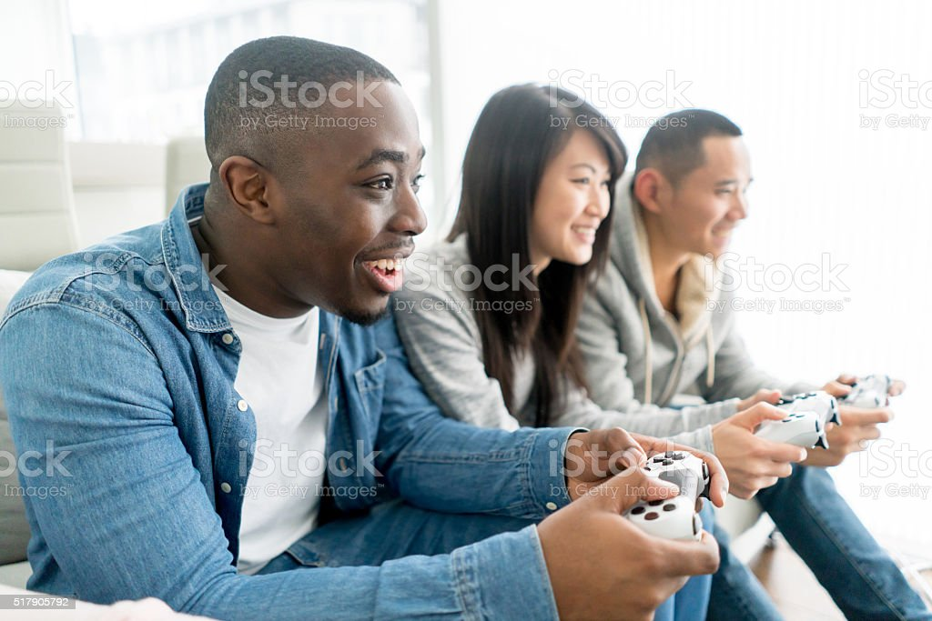 Friends playing video games stock photo