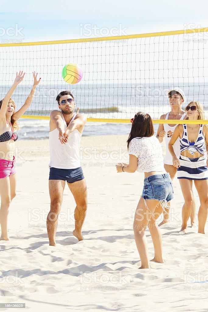 Friends playing volleybal royalty-free stock photo