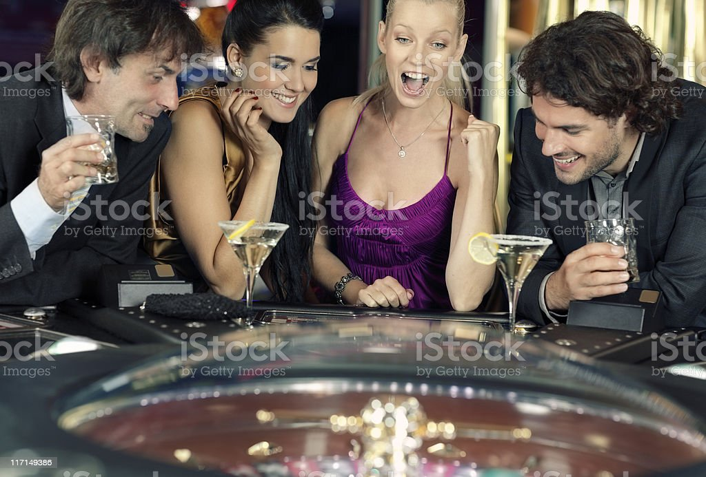friends plays in the casino on electronic roulette stock photo