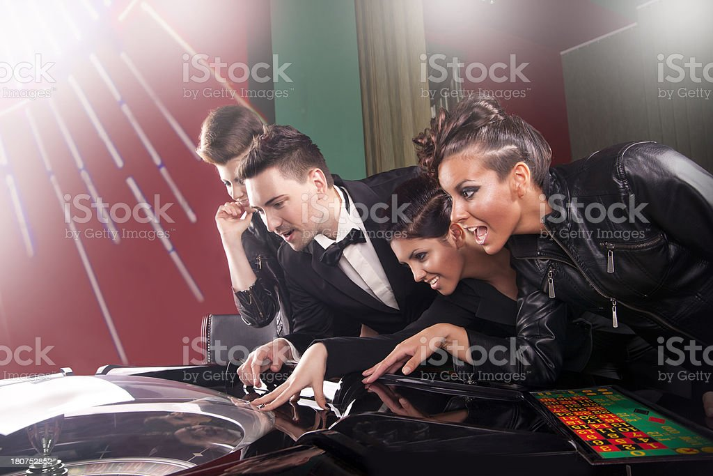 Friends plays in the casino on electronic roulette royalty-free stock photo