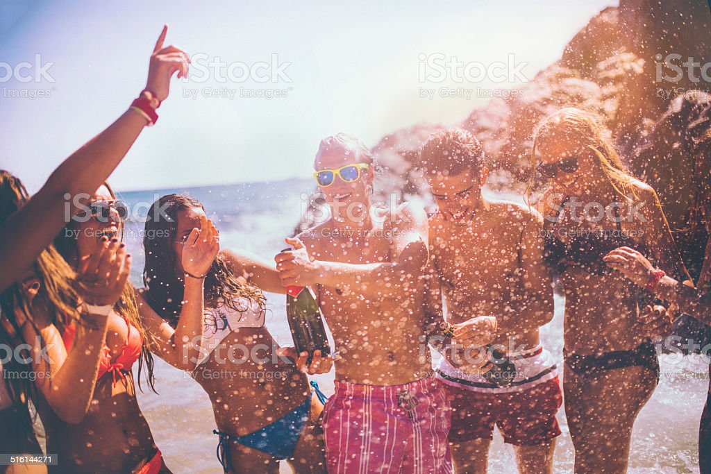 Friends Popping Champagne stock photo