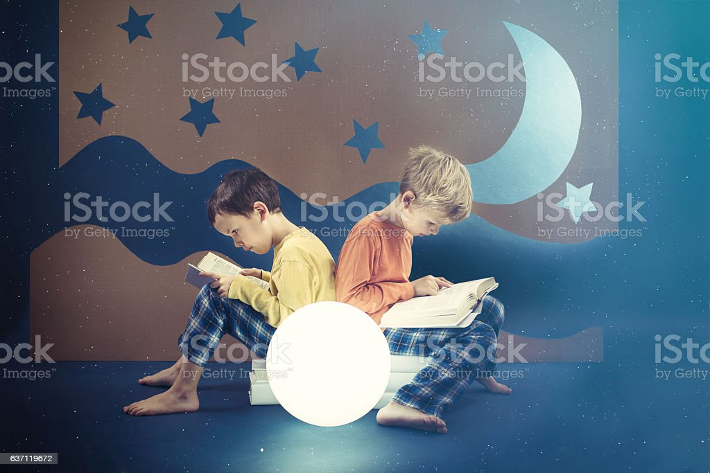 Friends preoccupied by reading books stock photo