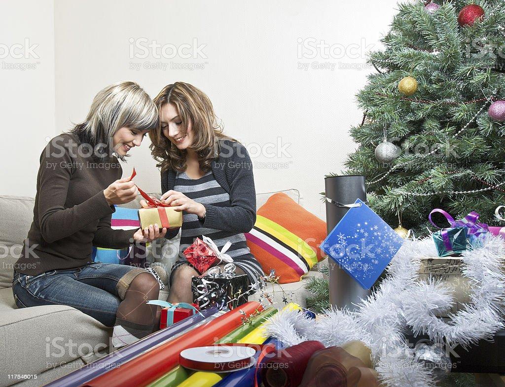 Friends Preparing Christmas Presents royalty-free stock photo
