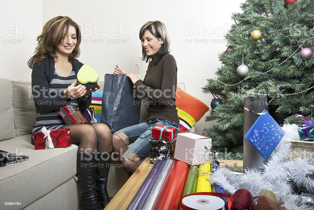 Friends Preparing Christmas Presents royalty-free stock photo
