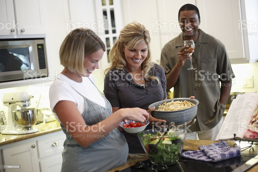 Friends Preparing dinner in the kitchen royalty-free stock photo