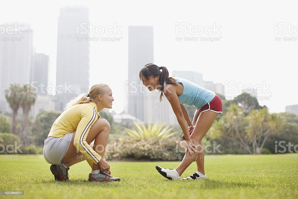 Friends preparing for exercise in park royalty-free stock photo