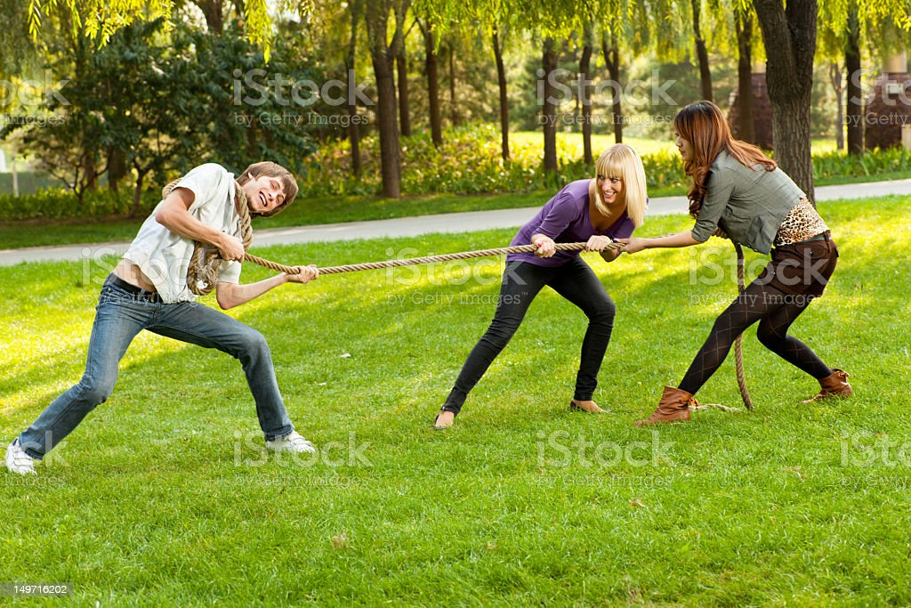 Friends pulling a rope royalty-free stock photo