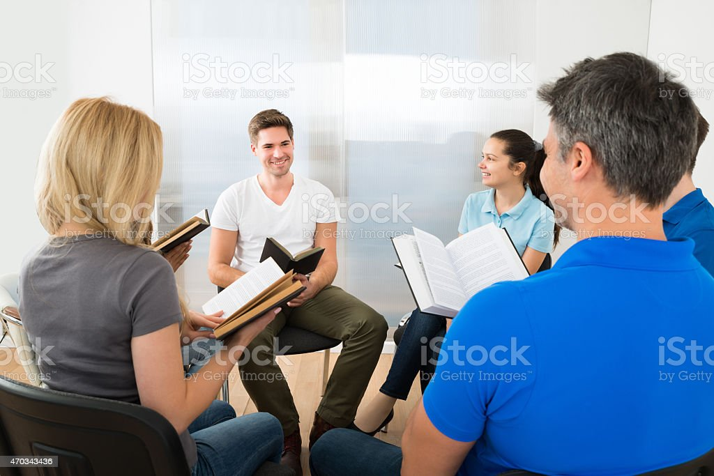 Friends Reading Bible stock photo