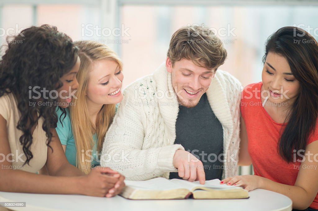 Friends Reading the Bible Together stock photo