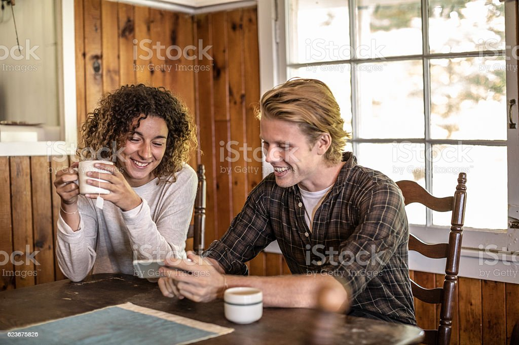 friends relax and enjoy an hot coffee at home stock photo