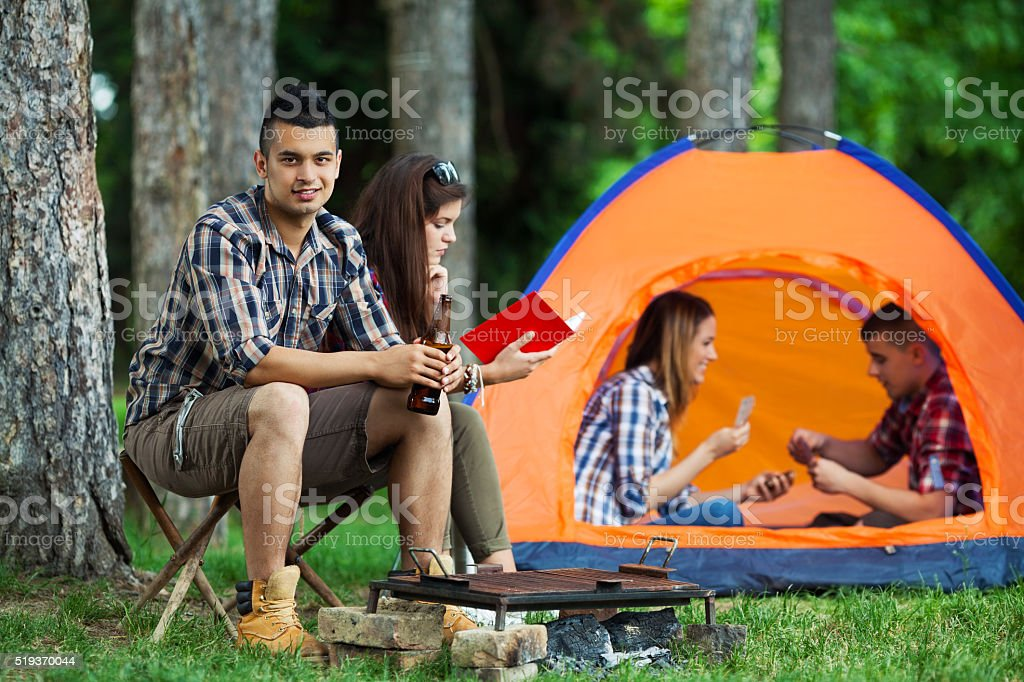 Friends Relaxing After Barbecue stock photo