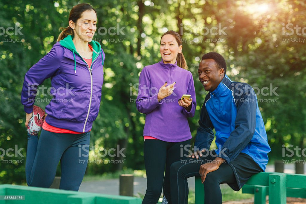 Friends Relaxing After Jogging stock photo