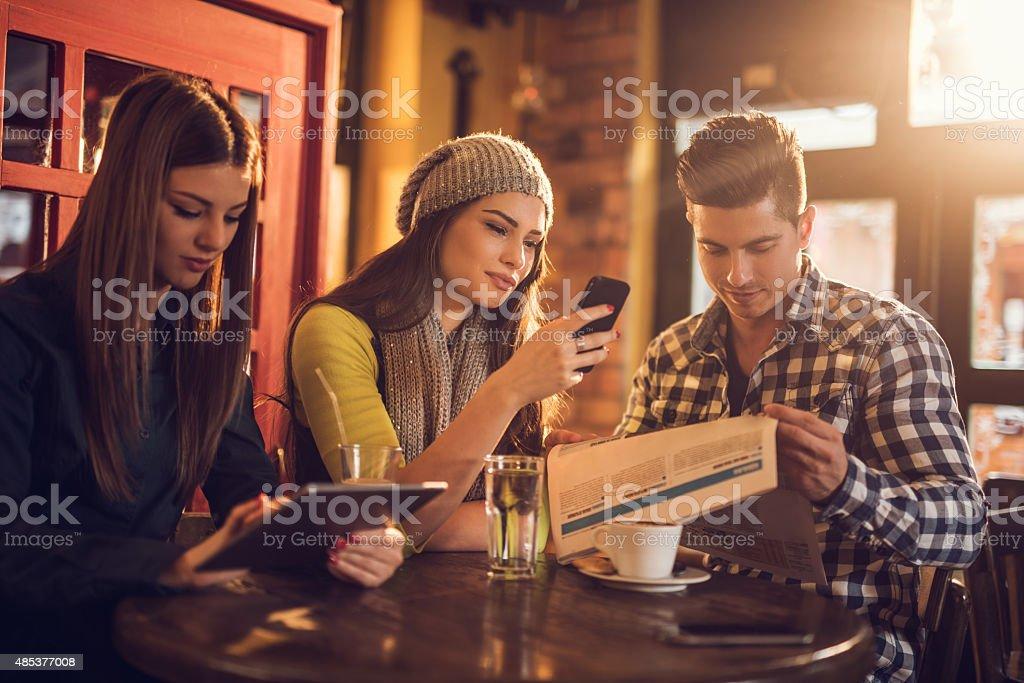 Friends relaxing in a cafe on a coffee break. stock photo