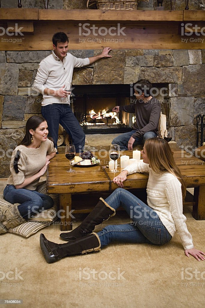 Friends relaxing in a chalet stock photo