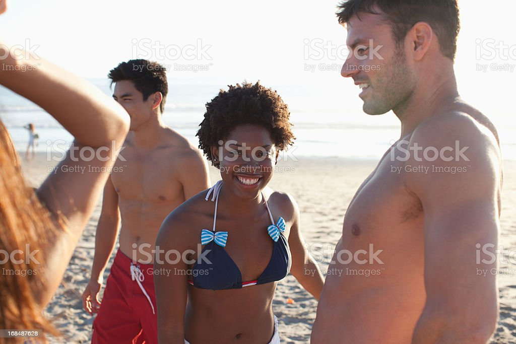 Friends relaxing on beach together royalty-free stock photo