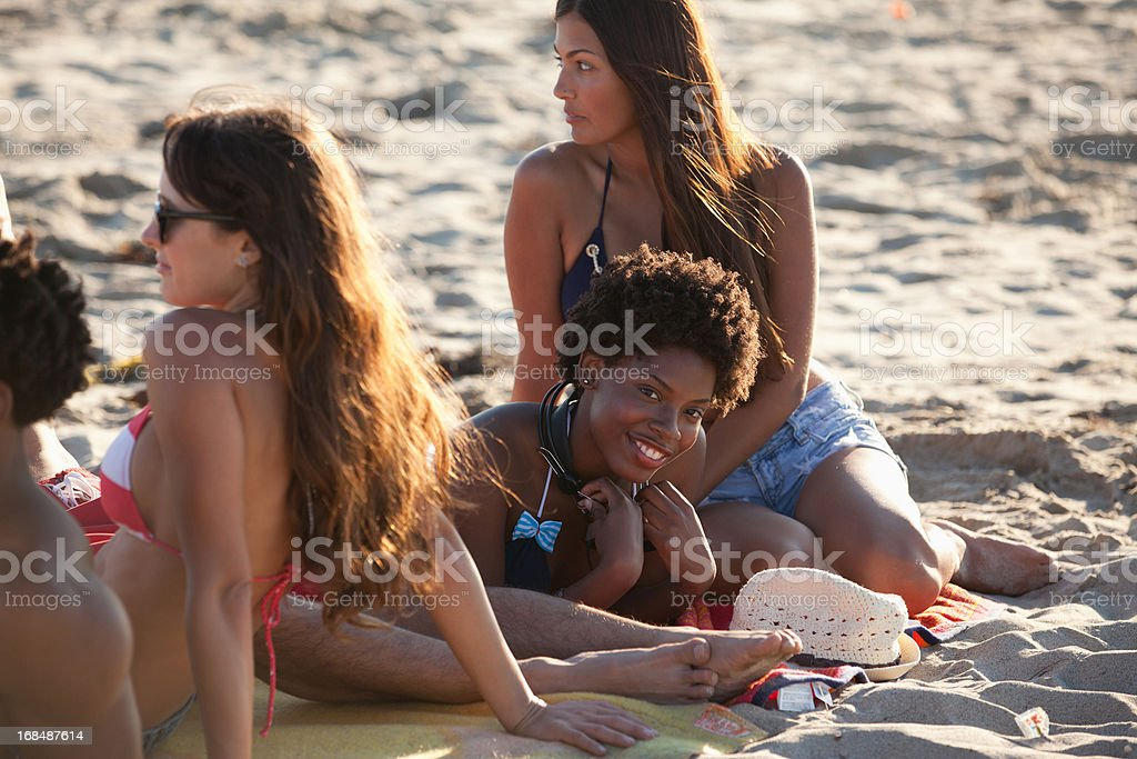 Friends relaxing together on beach royalty-free stock photo
