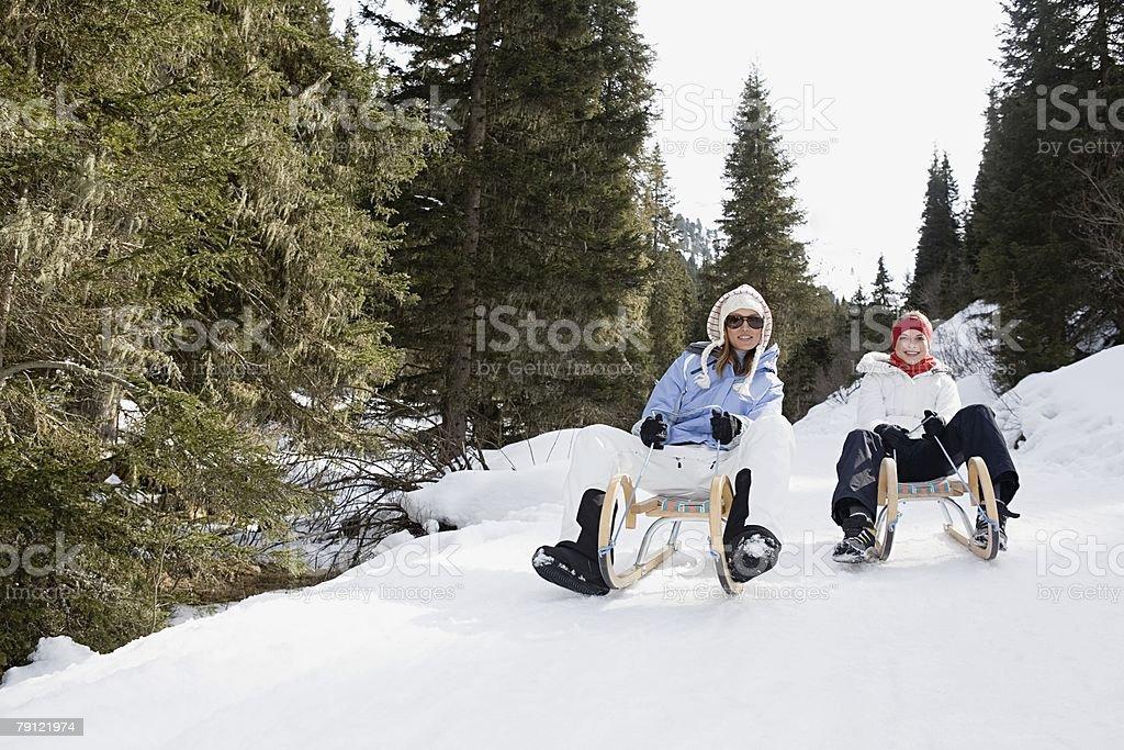 Friends riding a toboggan royalty-free stock photo