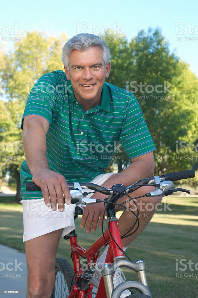 Friends riding bicycles stock photo